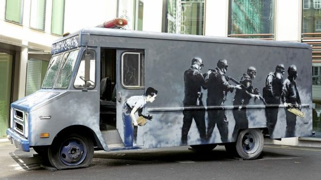 Banksy's Swat Van Sells for £218,000