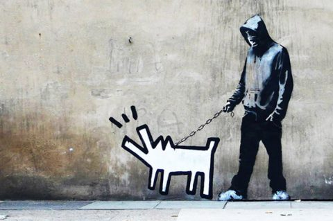 The Banksy image, Choose Your Weapon originally appeared in the Southern London district of Camberwell Southwark. Banksy executed this street art throw-up before it became his last publicly released print in 2010.